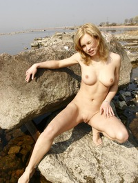 Busty Blonde Babe Poses Naked Outdoors 10