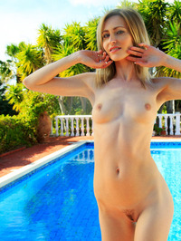 Sexy Blonde Babe Janelle B Is Hanging Out By The Pool 18